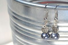 Silver dangle earrings with metal accent bead and charcoal glass pearl beads on Etsy, $10.00