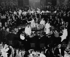 """Celebrating the End of Prohibition""  Men and women crowd a fancy club on Park Avenue to celebrate the end of Prohibition. (1933)"
