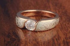 Mokume Wave Engagement Ring with a rose gold liner, White Mokume gane and a round white diamond.