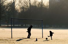 London, UK:   Children play football in Gunnersbury Park on Jan. 21.