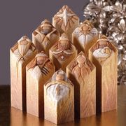 Pillars of Heaven Nativity.  I so want this Nativity set!! You can arrange the set so when you turn the wisemen and shepherds to the side there is scripture engraved on it.. Love it!!