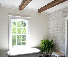 Wood beams, brick wall, plank walls and all in the same room is to die for! My Kentucky Home Tour Faux Wood Beams, Faux Brick, Brick And Stone, Whitewashed Brick, Grey Brick, Stone Walls, Brick Walls, Brick Bathroom, White Bathroom