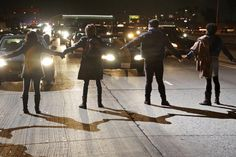 Protesters block the southbound lanes of the 110 freeway after the Los Angeles County Coroner released an autopsy report on the LAPD's shooting of Ezell Ford in Los Angeles, California December 29, 2014. REUTERS/Jonathan Alcorn
