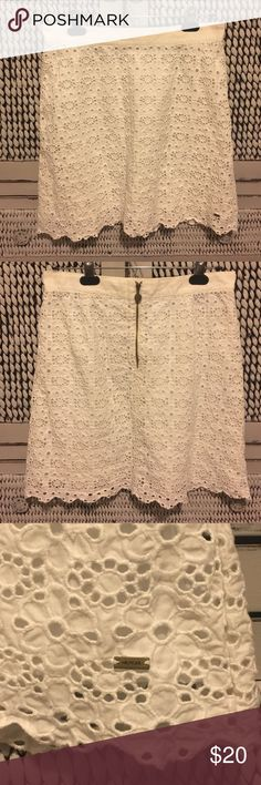 Tommy Hilfiger white eyelet skirt women's size 6 Tommy Hilfiger white eyelet skirt women's size 6.  Zip up in the back.  Very small metal Hilfiger emblem, at the front bottom left of skirt.  Good condition.  Super cute for Spring time! Tommy Hilfiger Skirts