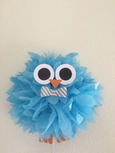 Owl themed baby shower. Made this owl out of tissue paper Pom pom and it turned out so cute! This is not linked to a website, it is only a picture.