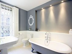 MathewF: Cast iron roll top bath with immaculate wooden panelling, chrome tapes and stunning ...