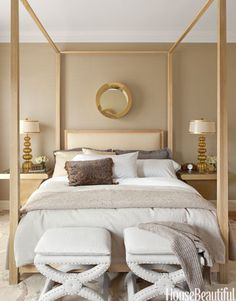 "Designer Benjamin Dhong balanced the ""masculine strength"" of the custom bed in a San Francisco row house with a vintage Curtis Jere brass porthole mirror and gold Murano glass lamps by Steve Jensen from William Switzer: ""I like the geometry of clean, straight lines and hard angles, but it can be oppressive. Circular elements are compelling and very human. - HouseBeautiful.com"