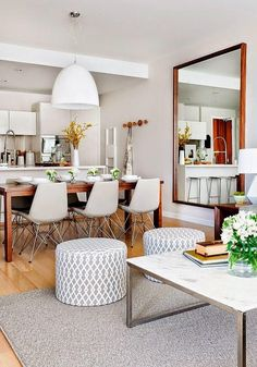 Enchanting Open Room Area of Dining and living room Design with Wood table and Coconut Chair and White Chandelier at False Creek Condo Design Condo Design, Apartment Design, Home Design, Design Ideas, Apartment Living, Apartment Therapy, Design Design, Condo Interior Design, Design Interiors
