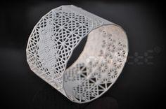3D Print Dentelle/lace bracelet by Miette.Join the 3D Printing Conversation: http://www.fuelyourproductdesign.com/