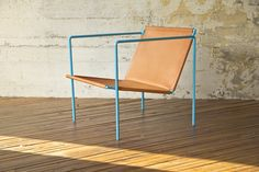 leather sling chair by @Casey Keasler. Truly fab!