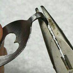 Bending of a silver or old spoon..