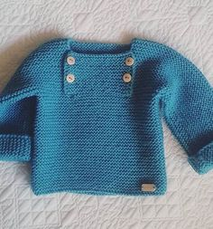 Free Knitting Pattern for Easy Garter Stitch Baby Pullover - The Natural Baby Pullover sweater is knit as a garter stitch tee shape with a buttoned front opening for easy dressing. Designed by Marta Porcel. Pictured project by cecu. Rated easy by Ravelrers. Available in English and Spanish. Aran weight yarn. #knittingpatternssweaters