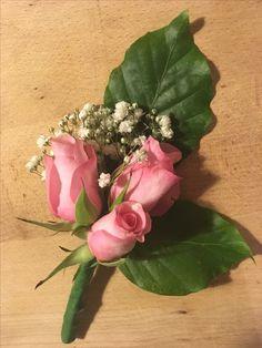 Trio of roses buttonhole