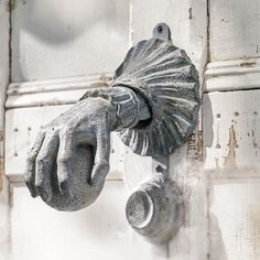 Raise your hand if you think our Haunted Door Knocker is the coolest way ever to announce arrivals at your Halloween party. Simply magic when it comes to    impressing guests, from the moment they darken your door. Fully-functioning knocker shows a realistic hand figure clutching an orb, and everything    possesses the unmistakable look of terrifically timeworn cast iron. Simply raise and lower the hand to knock  sturdy hinge, at the wrist, is set in a    matching decorative base. The per...