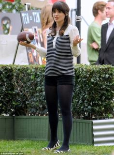 Zooey Deschanels black and white striped top with pearl buttons on New Girl