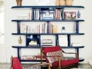 : Original Mid Century Modern Bookcases At Family Room Applied Red Upholstery Chairs Decor With Books And Old Vases And Pitch As Captivatin...
