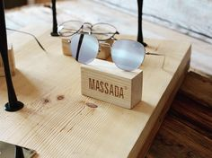 "SKEIN art installation by Massada, inspired  by Constantin Brâncuși sculptures. Window art display for ""Bird in Space"" eyewear frame exhilarated by Brâncuși ideas. Handcrafted in Japan, Titanium. Installation in polished cast brass, displayed on board crafted out of hundred years old recycled vintage European Spruce. #massadaeyewear #massada #massadaartprojects #birdinspacebymassada"