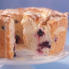 Angel food cake, appropriately named, is a godsend when it comes to big family gatherings. Everyone likes it, almost no one is allergic to it, and it provides a light, sweet ending to what is too often a sloth-inducing meal. Fresh blueberries color the cake purple, and a citrusy glaze gives it a festive feeling.