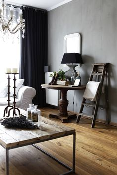 Black draperies with gray walls