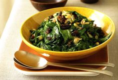 Sweet and savory play off one another in this simple side whose origins trace back to Spanish tapas. Just gently wilted spinach, plumped raisins, and toasted pine nuts.