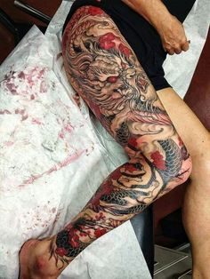 Japanese style full leg sleeve tattoo.