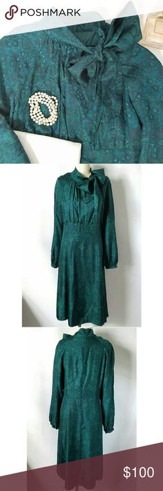 Vintage Blue Green Paisley Silk Dress Stunning!!! Teal green & navy blue paisley print Standing collar with tie neckline Long sleeves with single button closure at cuffs Center back zipper  Fully lined Midi length Excellent gently used condition!!  🌟PLEASE READ CLOSET INFO AND POLICIES POST🌟 Vintage  Dresses Long Sleeve