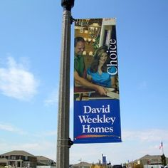 Custom avenue banner mounted to community light pole.