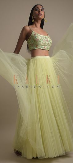 Buy Online from the link below. We ship worldwide (Free Shipping over US$100)  Click Anywhere to Tag Mint Green Skirt And Crop Top With Floral Embroidery Work Online - Kalki Fashion Mint green skirt fabricated in net.Teamed with a matching crop top with thread, beads and sequins embroidery in floral pattern.