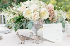 vintage centerpiece flowers in a large silver bowl with pheasant pewter accoutrements | Downton Abbey Wedding Inspiration | Alicia Lacey Photography