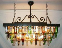 Recycling beer bottles into unique lighting - a chandelier for the guy's entertainment area