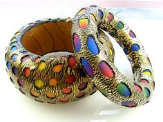 By Debbie Anne. Colored Polymer clay under crackled gold clay.