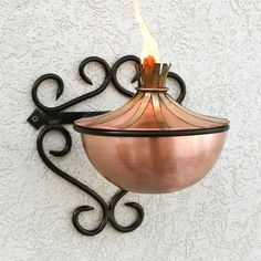 Brass Accented Copper Patio Torch with Filigree Wall Bracket - Antique Copper . $115.95. With its scroll detail, the Brass Accented Copper Patio Torch with Filigree Wall Bracket will instantly add a charming and inviting look to your outdoor living area. Great for a patio or even pairing on either side of an entryway. Torch is made of copper. Antique Copper finish with Brass accents. Bracket has a Black finish. Overall dimensions: 9-3/4 L x 9-1/2 W (front to back...