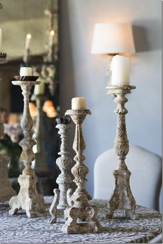 Old lamps turned into candle holders.I love to make them..each one is unique to itself. a collection of Aidan Gray candlesticks...