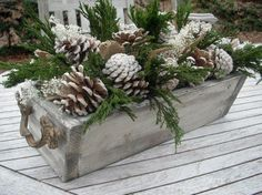 Spray pine cones with a little white spray paint to add a wintry touch! Pine cones and greenery in sewing drawer for an Upcycled recycled Christmas decor look. After Christmas, Noel Christmas, Country Christmas, Outdoor Christmas, Christmas Wreaths, Christmas Crafts, Coastal Christmas, Christmas Planters, Simple Christmas
