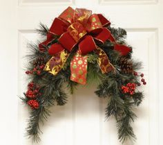 CR4839D - #Christmas Door Swag with beautiful red berries and an elegant red and gold bow.