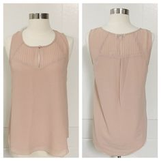 NWT Naked Zebra Pleated and Proper Top This beautiful, pleated, blush-colored top demonstrates the very best of Naked Zebra. 100% polyester. Size medium. Brand new with original tags ✨ Item #P013 Naked Zebra Tops Tank Tops