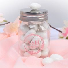 Your cherry blossom wedding theme would not be complete without these cute personalized mini mason jar favors for your guests. These ones have a lovely cherry blossom design and can be personalize with your names, initials, and the date of your wedding. #CherryBlossomMasonJarFavors #CherryBlossomWeddingThemeFavors #CherryBlossomThemedWeddingFavors