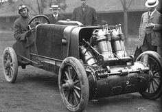 Barney Oldfield in his 1907 Christie. 20 Liter V4 transverse-mounted 30-horsepower engine; the crankshaft served as the front axle. Flywheels were coupled to the crank ends by leather-faced clutches and telescoping universal joints drove the front wheels.