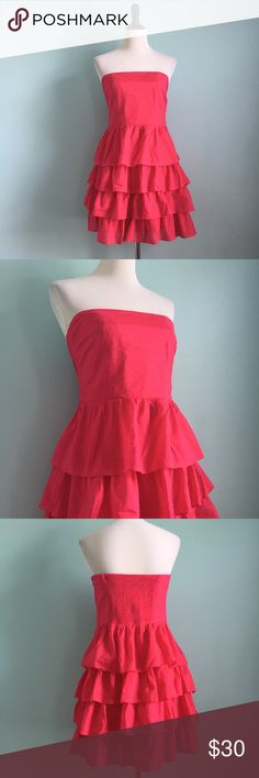 Strapless Hot Pink Tiered Dress Adorable hot pink strapless dress with Tiered layered skirt. So cute and in great condition! Stretchy back and hidden side zipper. Size 10 by Express. Express Dresses Strapless