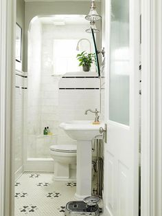 this is one of my all time favorite small bathrooms. black and white mosaic floor tile, frosted glass door, and classic pedestal sink. no shower curtain needed. bathroom ideas vintage Small Bathrooms by Design Style