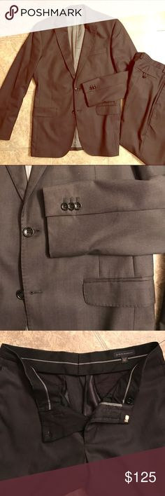 Banana Republic Men's Suit, Dark Gray Dark gray, almost black, handsome men's suit from Banana Republic. Made in Turkey. Jacket size 38R. 80% wool 20% silk shell, 54% cotton 46% viscose body lining, 100% Polyester sleeve lining. 2 button closure, pockets with interior pockets on either breasts. Light gray interior. Pants size 33/30. 80% wool 20% silk shell, 100% acetate lining. Flat front, straight leg. Smoke free home. No signs of wear Banana Republic Suits & Blazers Suits