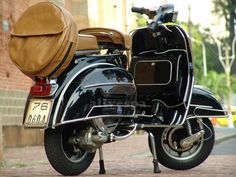 I love classic (Vespa) scooters.  Wish I lived in a city that it was the practical choice.