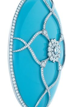 Turquoise is one of nature's most vivid and beautiful expressions. Oval turquoise pendant with diamonds in platinum. Tiffany & Co. View 2
