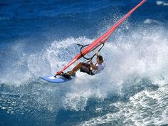 wind surfing - riding the wave
