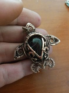 Wire wrapped around a jade(?) cabuchon to make a turtle!
