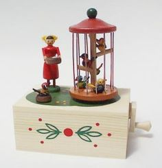 Hand cranked music box, the birdcage spins around as the music plays.