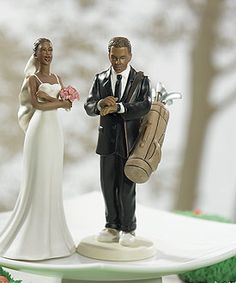 Golfing may be his life but how far will he go? This light-hearted Golf Fanatic Groom takes a fun jab at his hobby. Co-ordinated here with our Exasperated Bride. Or, select any other Mix and Match Cake Topper to create the perfect couple. Hand painted porcelain Available in Caucasion or Ethnic.   Materials Porcelain