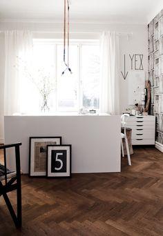 Herringbone wood floors in a workspace home office.