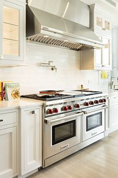 The double oven in the kitchen of a home in Southampton, N.Y. There are a total of three ovens, two warming drawers, three prep areas and two sets of fridge/freezer combinations in the home.