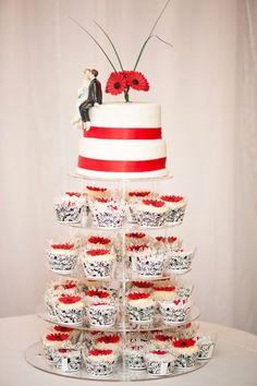 Not this design, but I like the idea of top tiers of a cake and then either cupcakes or mini-cakes for guests to enjoy.